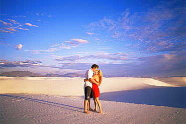 Couple kissing, White Sands National Monument, New Mexico, United States of America, North America