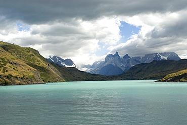 The two towers stand in front of Rio Paine in Torres del Paine National Park, Chile, South America