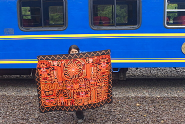 Traditional blanket for sale at train stop on way to Machu Picchu, Peru, South America