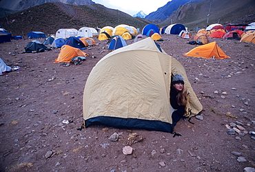 Woman wakes up at Confluencia Base Camp in Aconcagua National Park, Argentina, South America