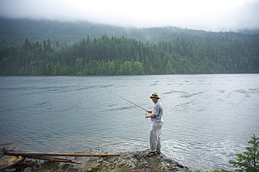 Man, 30 years old, fishes on Ross Lake, North Cascades National Park, Washington, United States of America, North America