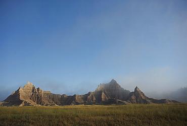 Morning mist rises in Badlands National Park, South Dakota, United States of America, North America