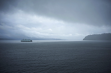 A ferry boat moves through stormy weather from Vashon Island to West Seattle. Washington State, United States of America, North America