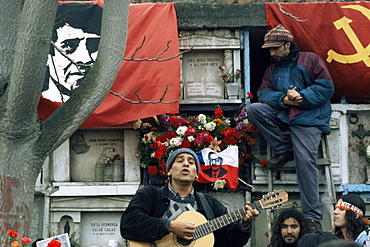 Guitarist plays Victor Jara songs at his grave on 11th de Septiembre, remembering Victor Jara whose hands were cut off in the National Stadium and who was then killed during the Pinochet regime, Santiago, Chile, South America