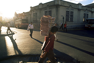 Morning activity on the streets, boy carrying newspapers, San Jose, Costa Rica, Central America