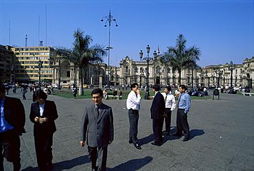 Business people talking on the Plaza de Armas, Lima, Peru, South America