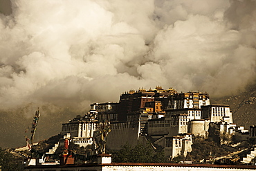 Image taken in 2006 and partially toned, dramatic clouds building behind the Potala Palace, UNESCO World Heritage Site, Lhasa, Tibet, China, Asia