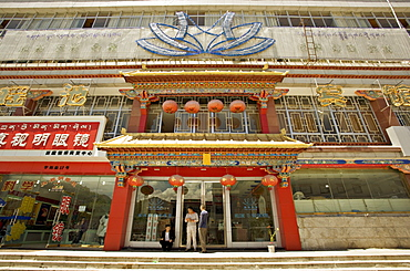Modern shops line the Yutok Lam a street connecting the Jokhang temple to the Potala square, Lhasa, Tibet, China, Asia