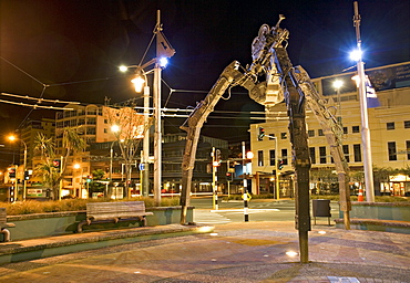 Tripod and movie camera sculpture, at night, reflecting the growing film industry, with the nickname Wellywood, in Wellington, North Island, New Zealand, Pacific