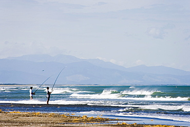 Fishing from the shore, Manawatu, west coast of the North Island, New Zealand, Pacific