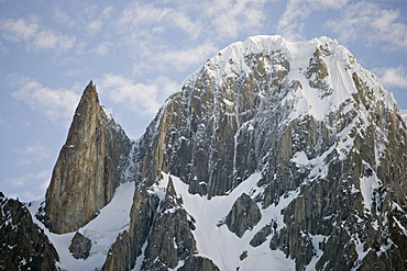 On the left the granite spire known as Lady Finger peak, or Bubulimating, summit 6,000m, high above Karimabad in the Karakoram mountains of the Northern Areas, Pakistan. On the right, Ultar Peak, 7388m and 73rd highest mountain in the world.