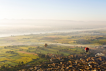 Hot air balloons over the West Bank (Western Thebes), Thebes, Egypt, North Africa, Africa