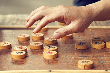 Chinese chess board and player's hand, Huangshan City (Tunxi), Anhui Province, China, Asia