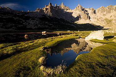 Cerro Catedral reflected in a tarn, Bariloche, Rio Negro, Argentina, South America