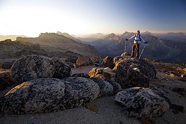 Hiker at sunrise, Cathedral Provincial Park, British Columbia, Canada, North America