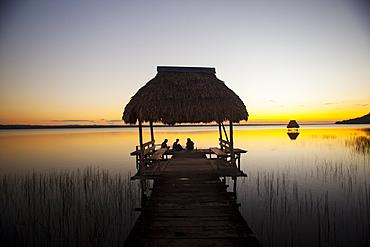People relaxing at sunset, Lago Peten Itza, El Remate, Guatemala, Central America