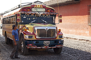 Chicken bus attendant calling for more passengers, Antigua, Guatemala, Central America