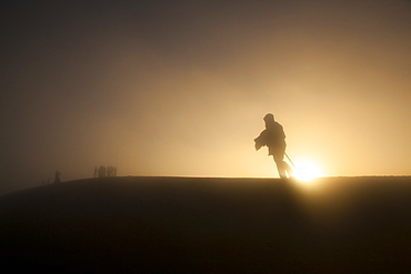 Woman walking in the fog atop Volcan Acatenango, Guatemala, Central America