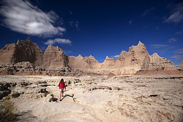 Woman Hiking, Badlands National Park, South Dakota, United States of America, North America