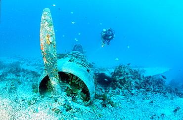 Sunken aeroplane and scuba diver, Papua New Guinea, Pacific Ocean