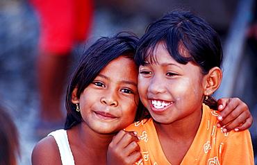 Two indonesian girl, Indonesia, Sulawesi, Celebes, Fishing village Lamanggau