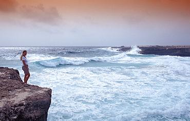 Woman and stormy coast, Netherlands Antilles, Bonaire, Caribbean Sea, Washington Slagbaai National Park, Playa Chikitu