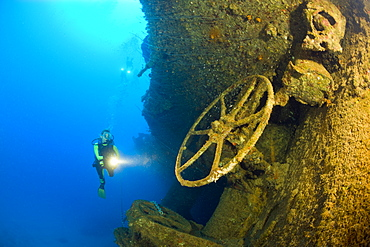 Diver explores Wheels and Wreckage of HIJMS Nagato Battleship, Marshall Islands, Bikini Atoll, Micronesia, Pacific Ocean