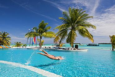 Tourist in Pool of Maldive Island Kandooma, South Male Atoll, Maldives