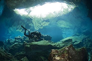 Cave Diver in Chac Mool Cenote, Playa del Carmen, Yucatan Peninsula, Mexico