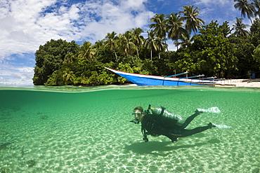 Scuba diver in Lagoon of Ahe Island, Cenderawasih Bay, West Papua, Indonesia, Southeast Asia, Asia