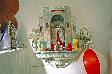 Charms and objects placed on a Santeria altar in a home in the Los Pinos area of Havana, Cubo