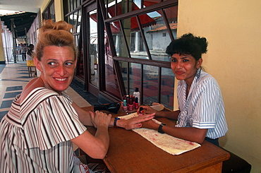 Nueva Gerona, main street, with beautician doing nails, Isle of youth, Cuba