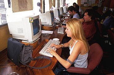 Students and travelers in the Papayanet Cyber Cafe on Avenida Juan Leon Mera in the New Town area of the city, Quito, Ecuador