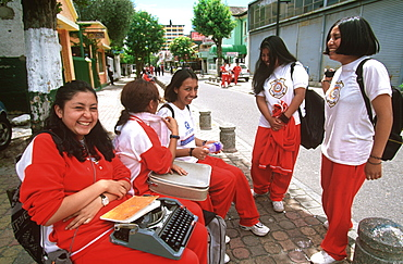 Ecuador's capital and second largest city students going to Manuela Canizares Girls School for typing classes in New Town area, Quito, Ecuador