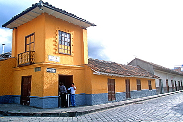 Cuenca World Heritage City & Ecuador's third largest city, famous for its colonial architecture colonial buildings on cobblestone street, Highlands, Ecuador