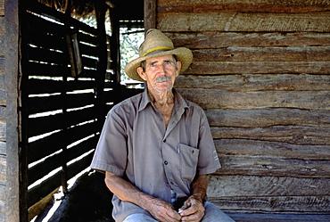 Portrait of a campesino or farmer in his home in Pinar del Rio Province in western Cuba, Cuba