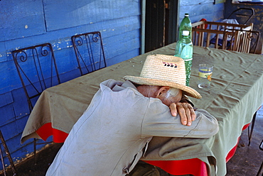 Portrait of a campesino farmer sleeping on the porch of his home in La Habana Province in central Cuba, Cuba