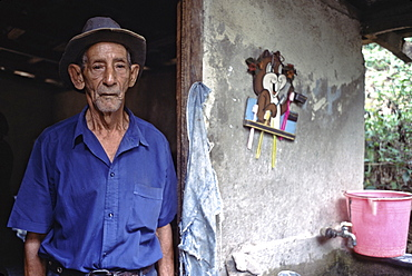 Portrait of a campesino in the doorway of his home near the town of Baracoa in eastern Cuba, Cuba