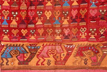 Lambayeque Culture, c 100-800AD skirt with human and animal forms N Coast near Trujillo Museo Rafael Herrera, Lima, Peru