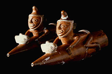 Precolumbian Ceramics Mochica (Moche) Culture 100-700AD fishermen riding on 'Totora' traditional reed boats in the collection of the Museo Amano, Lima, Peru