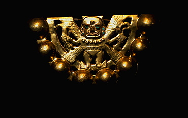Gold Artifacts Moche (Mochica) Culture, 100 to 700AD, NCoast gold rattle from Lord of Sipan Tomb, 300AD, represents 'Decapitator' Moche supreme deity, Peru