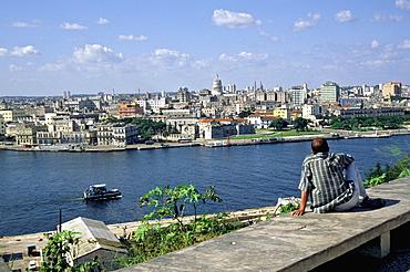 A view of Havana's skyline across the harbor from the battlements of the Forteleza de San Carlos de la Cabana in Casablanca area, Habana Vieja, Havana, Cuba