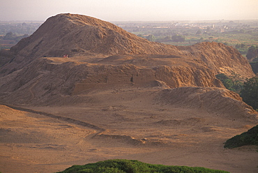 Mochica Culture La Huaca del Sol (Temple of the Sun) built in 100-700AD world's largest adobe structure (1/3 of original size) pyramid and landscape, Peru
