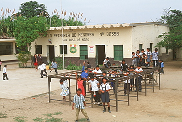 Small rural school and students in playground during recess, in town of San Jose de Moro outside Pacasmayo south of Chiclayo, North Coast, Peru