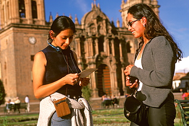 Ancient capital of the Incas the Plaza de Armas in the colonial center of the city Peruvian students with the Cathedral beyond, Cuzco, Highlands, Peru