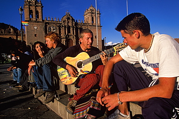Ancient capital of the Incas the Plaza de Armas in the colonial center of the city a favorite gathering place for foreign students, Cuzco, Highlands, Peru