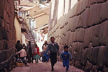 Ancient Inca capital Calle Hatunrumiyoc near the Plaza de Armas has some of the most finely constructed Inca walls, Cuzco, Peru