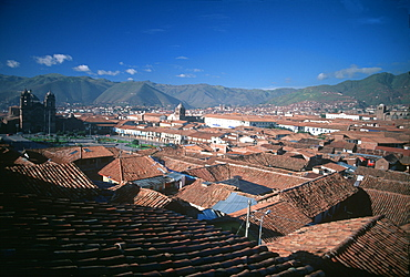 Ancient Inca capital view toward the Plaza de Armas across the terra cotta tiled roofs of the old city, Cuzco, Peru
