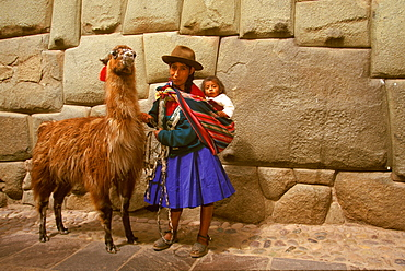 Calle Hatunrumiyoc near the Plaza de Armas contains some of the finest Inca stonework including the famous twelve sided stone, Cuzco, Highlands, Peru