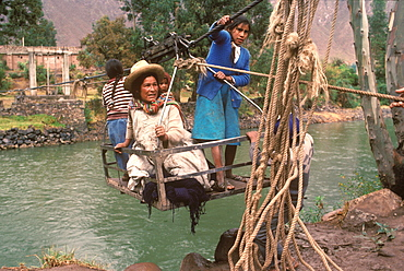 Small cable car holding passengers suspended over the Urubamba River near Cuzco useful technology where there are no bridges, Andes Mountains, Highlands, Peru